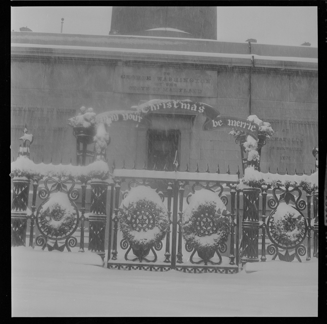 This photograph by A. Aubrey Bodine shows the greenery that the graden club decorated the base of the monument with in 1962, 10 years before the first lighting. BCLM, B391-F, MdHS