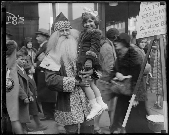 Santa holding little girl, ca 1930, A. Aubrey Bodine, MdHS, MC7723-5.