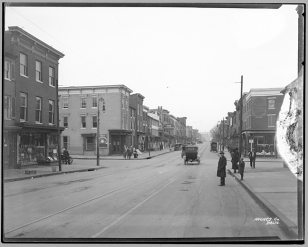 Baltimore Street, 900 block west, looking east, 1920, Hughes Company, MdHS, MC6284. A sign for the New Aladdin Theater is visible in the center of the photograph.